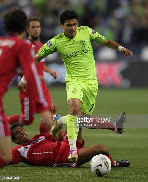 Fredy Montero of the Seattle Sounders FC dribbles against the Chicago Fire during the 2011 Lamar Hunt US Open Cup Final at CenturyLink Field on...