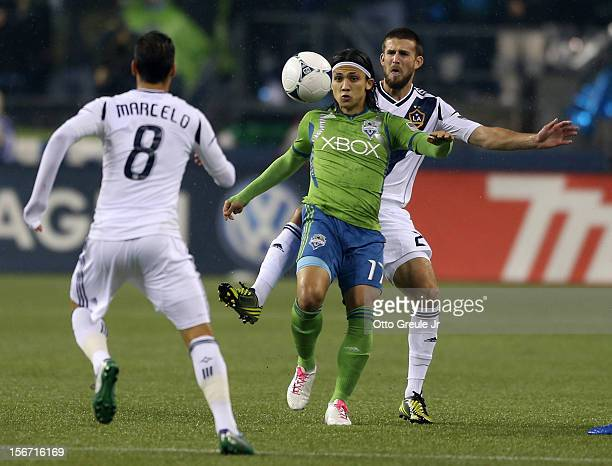 Fredy Montero of the Seattle Sounders FC dribbles against Todd Dunivant and Marcelo Sarvas of the Los Angeles Galaxy during Leg 2 of the Western...