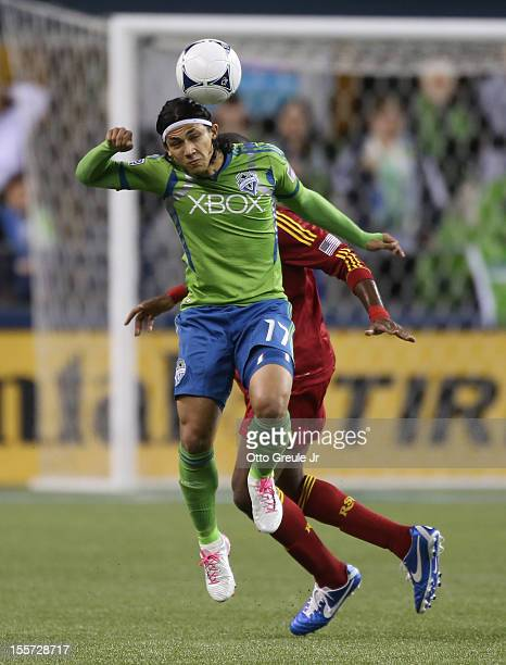 Fredy Montero of the Seattle Sounders FC heads the ball against Kwame WatsonSiriboe of Real Salt Lake at CenturyLink Field on November 2 2012 in...