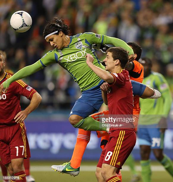 Fredy Montero of the Seattle Sounders FC heads the ball against Will Johnson of Real Salt Lake at CenturyLink Field on November 2 2012 in Seattle...