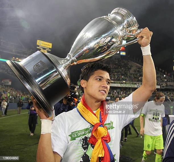 Fredy Montero of the Seattle Sounders FC holds the US Open Cup trophy after defeating the Chicago Fire 20 in the 2011 Lamar Hunt US Open Cup Final at...
