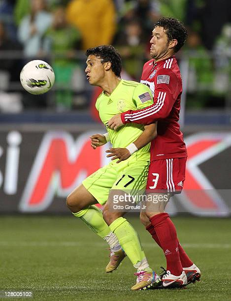 Fredy Montero of the Seattle Sounders FC is wrapped up in front of the goal by Dan Gargan of the Chicago Fire during the 2011 Lamar Hunt US Open Cup...