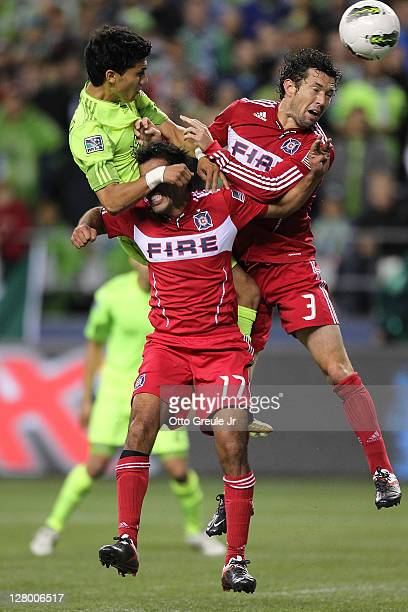 Fredy Montero of the Seattle Sounders FC shoots a header against Pavel Pardo and Dan Gargan of the Chicago Fire during the 2011 Lamar Hunt US Open...
