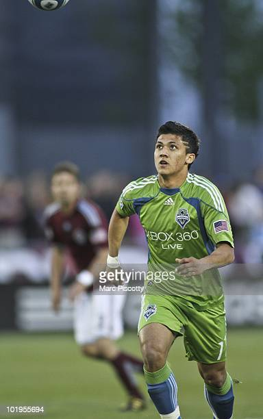 Fredy Montero of the Seattle Sounders FC tries to corral a bouncing ball during the first half against the Colorado Rapids at Dick's Sporting Goods...