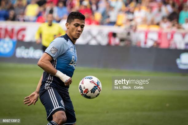 Fredy Montero of the Vancouver Whitecaps FC kicks the ball to gain control during the MLS match between New York Red Bulls and Vancouver Whitecaps FC...