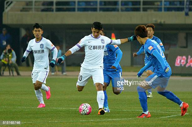 Fredy Montero of Tianjin Teda drives the ball during the Chinese Football Association Super League match between Tianjin Teda and Guangzhou RF at...