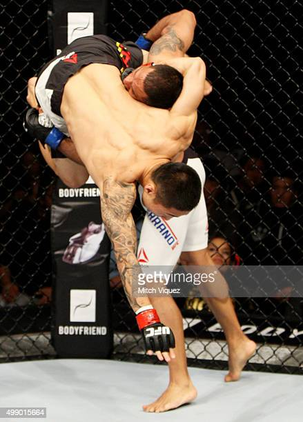 Fredy Serrano of Colombia goes for a takedown on Yao Zhikui of China in their flyweight bout during the UFC Fight Night at the Olympic Park...