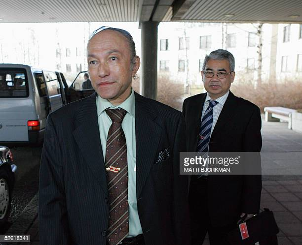 Free Aceh Movement chief negotiator, Health and Foreign Minister Zaini Abdullah , and Prime Minister Malik Mahmud leave their hotel in Espoo 12 April...