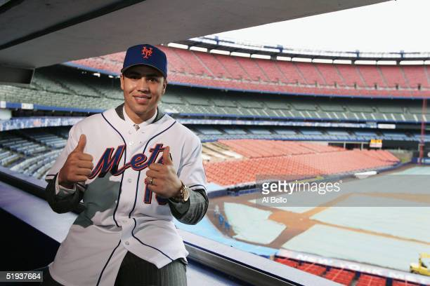 Free agent Carlos Beltran of the New York Mets poses during the press conference announcing his signing January 11 2005 at Shea Stadium in Flushing...