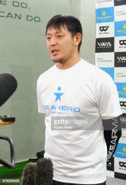 Free agent pitcher Hisashi Iwakuma speaks to reporters in Tokyo on Nov 20 2017 Iwakuma said he has received an offer to rejoin the Seattle Mariners...