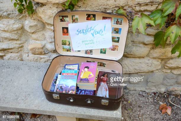 free books in old suitcase help yourself - free of charge stock pictures, royalty-free photos & images