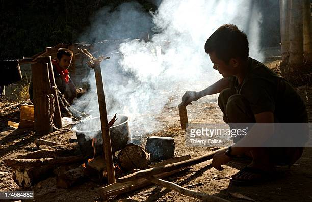 Free Burma Rangers member cooks on a fire during a relief mission in a displaced people communities in the jungle of the Northern Karen State For...
