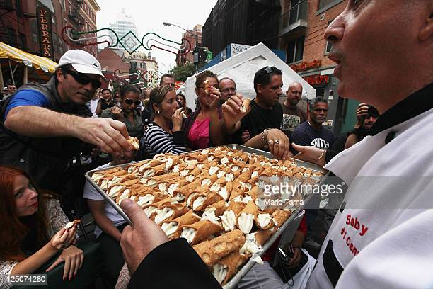 Free cannolis are passed out at the 85th annual Feast of San Gennaro festival September 15 2011 in New York City The annual Italian festival has...