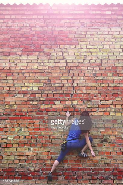 Free climbing on a brick wall