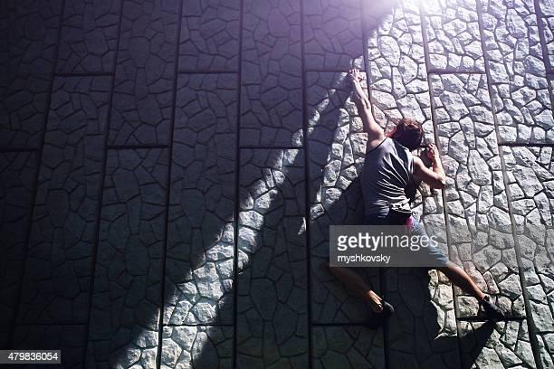 Free climbing on a concrete wall