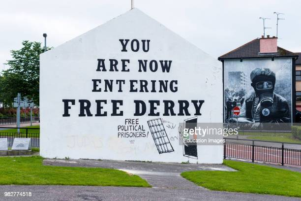 Free Derry' sign and Mural on the wall of house in Bogside, Londonderry, Northern Ireland.