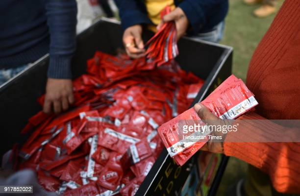Free distribution of condoms as people gather to observe the International Condom Day 2018, an event organized by Aids Health care Foundation at...
