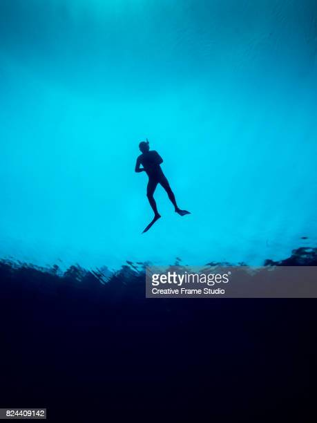 Free diver floating in the surface