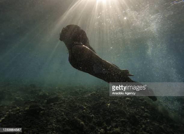 Free diver swims in the sea of a Gocek bay on July 05 Mugla, Turkey. Gocek bays are preferred by free divers because of the water temperature and the...