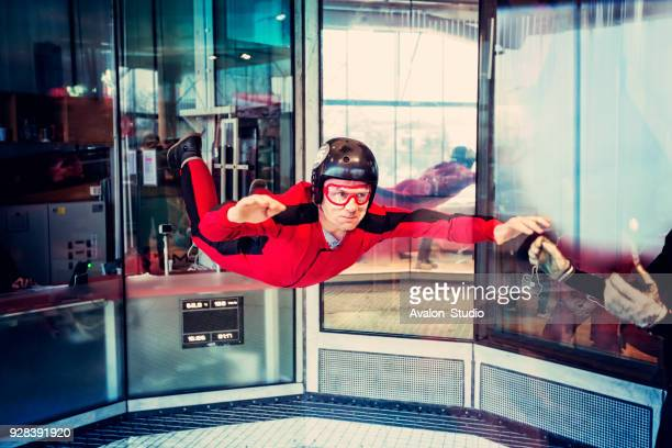 free flight in the wind tunnel. - aerodynamic stock pictures, royalty-free photos & images