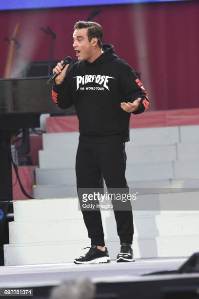 SALES free for editorial use In this handout provided by 'One Love Manchester' benefit concert Robbie Williams performs on stage on June 4 2017 in...