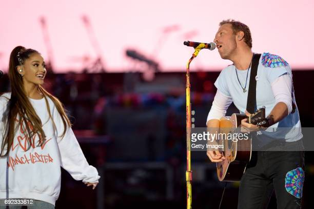 SALES free for editorial use In this handout provided by 'One Love Manchester' benefit concert Ariana Grande and Chris Martin perform on stage on...