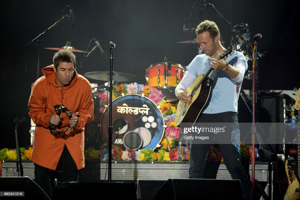 NO SALES, free for editorial use. In this handout provided by 'One Love Manchester' benefit concert (L) Liam Gallagher and Chris Martin perform on stage on June 4, 2017 in Manchester, England. Donate at www.redcross.org.uk/love
