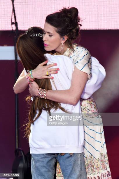 SALES free for editorial use In this handout provided by 'One Love Manchester' benefit concert Ariana Grande and Imogen Heap perform on stage on June...