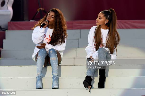 SALES free for editorial use In this handout provided by 'One Love Manchester' benefit concert Victoria Monet and Ariana Grande perform on stage on...