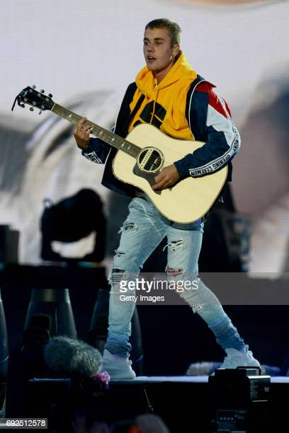 SALES free for editorial use In this handout provided by 'One Love Manchester' benefit concert Justin Bieber performs on stage on June 4 2017 in...