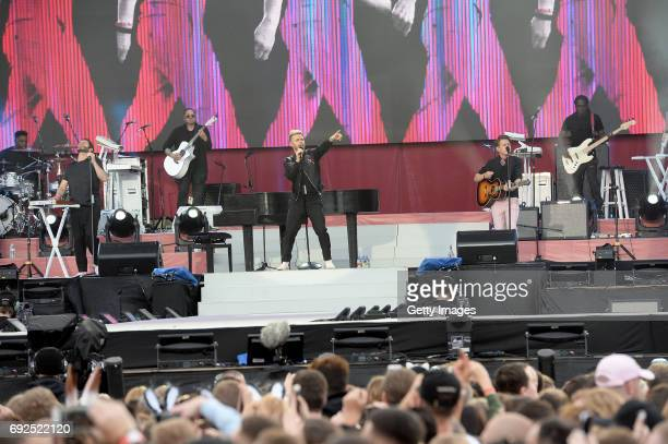 SALES free for editorial use In this handout provided by 'One Love Manchester' benefit concert Howard Donald Gary Barlow and Mark Owen of Take That...