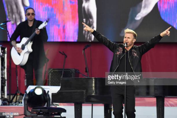 SALES free for editorial use In this handout provided by 'One Love Manchester' benefit concert Gary Barlow of Take That performs on stage on June 4...