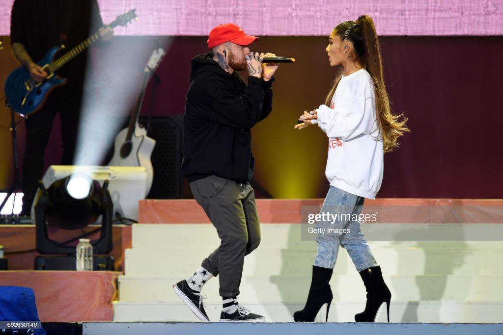 NO SALES, free for editorial use. In this handout provided by 'One Love Manchester' benefit concert (L) Mac Miller and Ariana Grande perform on stage on June 4, 2017 in Manchester, England. Donate at www.redcross.org.uk/love