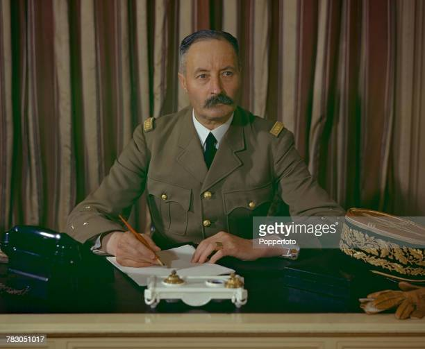 Free French Army General Henri Giraud pictured wearing military uniform seated at his desk in London in August 1943