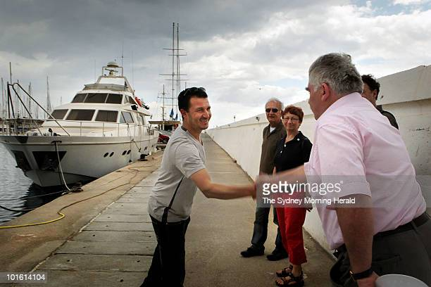 Free Gaza Movement member Fathi Jaoudi greets German passengers Nadar AlSakka Norman Paech and German MP Inge Hoger who will join the Freedom...