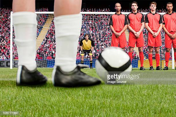 free kick during a football match - defender soccer player stock pictures, royalty-free photos & images
