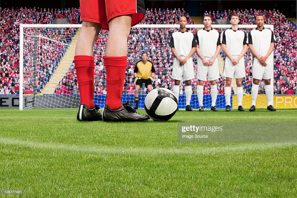 Free kick during a football match : Stock Photo