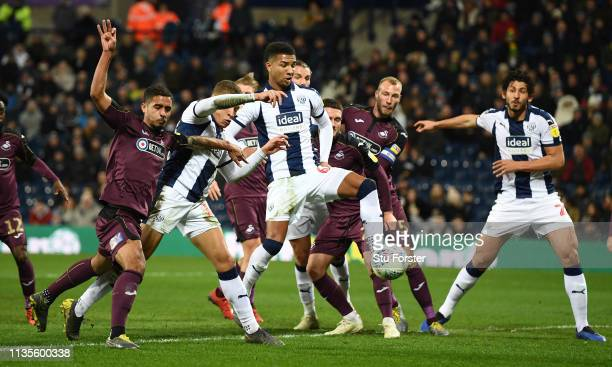 A free kick from WBA player Chris Brunt goes straight into the net past the attentions of the players in the box including Mason Holgate during the...