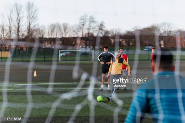 free kick - striker stock pictures, royalty-free photos & images