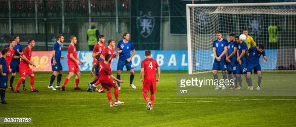free kick - defender soccer player stock photos and pictures