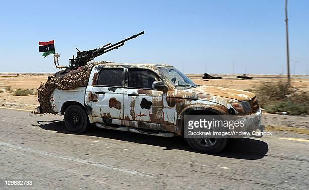 a free libyan army pickup truck with a zpu-1 anti-aircraft gun, ajdabiya, libya. - us army urban warfare stock photos and pictures