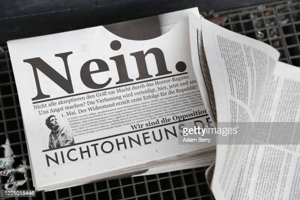 Free newspaper by protesters demonstrating against restrictions on public life designed to stem the spread of the coronavirus, or COVID-19, on April...