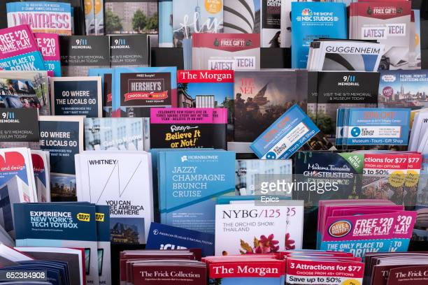Free pamphlets and sightseeing guides to popular tourist spots and destinations in New York City outside a store on Broadway March 11 2017