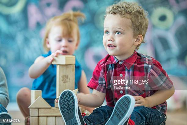 free play - black ginger baby stock photos and pictures