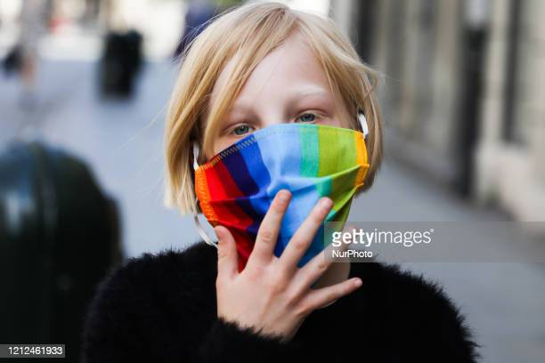 Free rainbow face masks are distributed during coronavirus pandemic by members of Krakow Equality Centre DOM EQ. Krakow, Poland on May 10th, 2020....