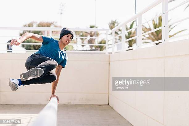 Free running parkour athlete in the beach of Barcelona