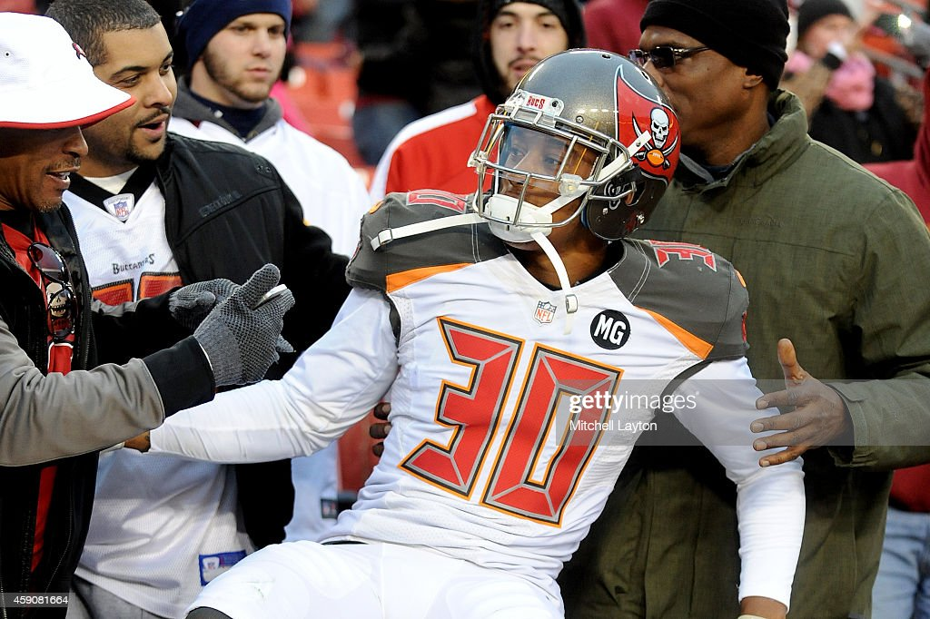 Free safety Bradley McDougald #30 of the Tampa Bay Buccaneers celebrates following the Tampa Bay Buccaneers 27-7 win over the Washington Redskins at FedExField on November 16, 2014 in Landover, Maryland.