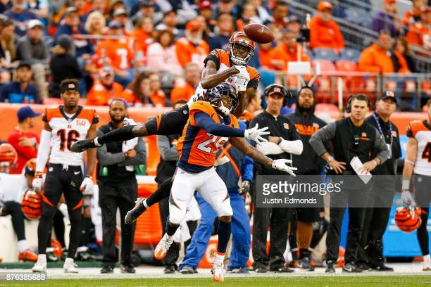 Free safety Bradley Roby of the Denver Broncos defends a pass intended for wide receiver AJ Green of the Cincinnati Bengals int he first half of a...