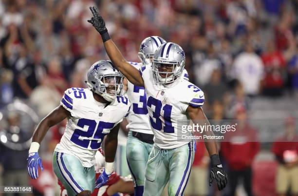 Free safety Byron Jones of the Dallas Cowboys reacts with safety Xavier Woods of the Dallas Cowboys after breaking up a fourth down pass during the...