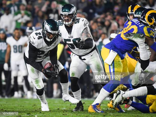 Free safety Corey Graham of the Philadelphia Eagles makes an interception in the third quarter against the Los Angeles Rams at Los Angeles Memorial...
